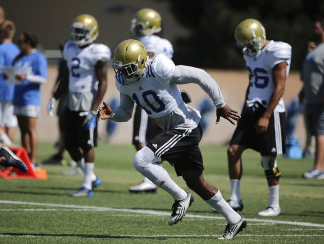 UCLA defensive back Fabian Moreau, center, sprints during NCAA college football practice Wednesday, Aug. 20, 2014, in Los Angeles.