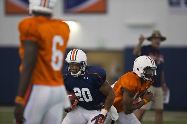 Auburn running back Corey Grant (20) takes a handoff during a drill at an NCAA college football practice Tuesday, Aug. 5, 2014, in Auburn, Ala.