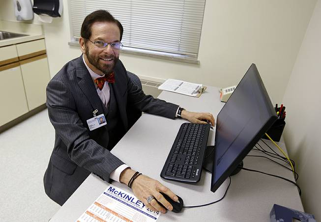 Dr. Robert Palinkas, director of the McKinley Health Center at the University of Illinois, poses in an exam room in Urbana, Ill., Thursday, Aug. 21, 2014. Extra health checks are part of protocols campuses throughout the United States have in place as they prepare for as many as 10,000 students from Nigeria, Guinea, Liberia and Sierra Leone, where more than 1,000 people have died in the worst Ebola outbreak in history.