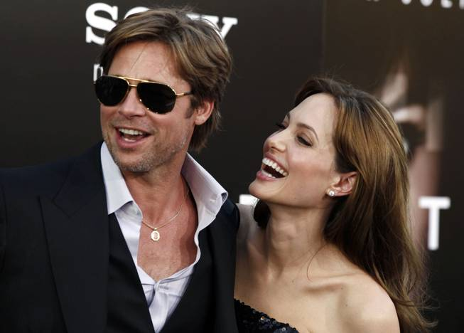 "In this Monday, July 19, 2010, file photo, cast member Angelina Jolie and Brad Pitt arrive at the premiere of ""Salt"" in Los Angeles."