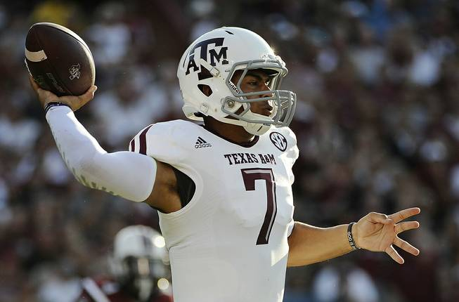 Texas A&M quarterback Kenny Hill throws against South Carolina during the first half of an NCAA college football game on Thursday, Aug. 28, 2014, in Columbia, S.C.