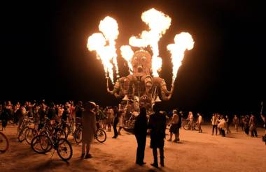In this Aug. 27, 2014 photo, participants enjoy the Burning Man festival on the Black Rock Desert in Gerlach, Nev. Organizers call Burning Man the largest outdoor arts festival in North America, with its drum circles, decorated art cars, guerrilla theatrics and colorful theme camps.