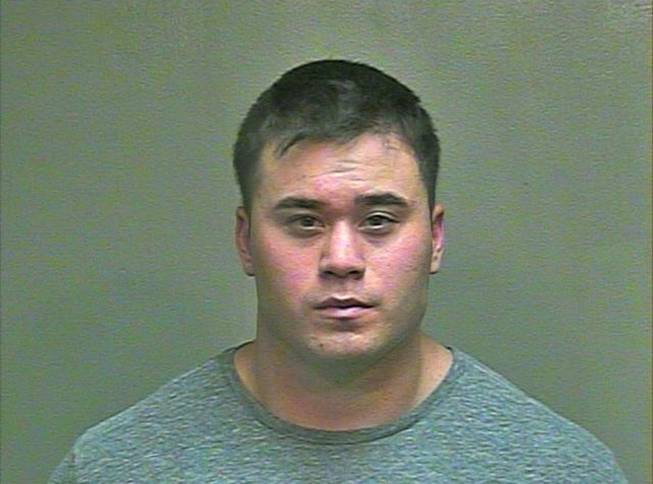 FILE - This Aug. 21, 2014 file photo made available by the Oklahoma County Sheriff's Office shows Daniel K. Holtzclaw. The 27-year-old Oklahoma City police officer was charged Friday, Aug. 29, 2014, with 16 counts including rape and sexual battery after he was accused of assaulting at least seven women while on patrol.
