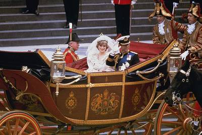 In this July 29, 1981 file photo, the carriage carrying the Prince and Princess of Wales passes along Trafalgar Square on its way from St. Paul's Cathedral to Buckingham Palace after the royal wedding in London. A 33-year-old slice of cake from Prince Charles and Princess Diana's 1981 wedding has sold at auction for $1,375.
