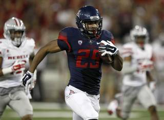 Arizona running back Austin Hill (29) scores a touchdown against UNLV during the second half of an NCAA college football game, Friday, Aug. 29, 2014, in Tucson, Ariz. (AP Photo/Rick Scuteri)