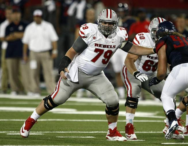 UNLV offensive linesman Robert Waterman (79) against Arizona during the first half of an NCAA college football game, Friday, Aug. 29, 2014, in Tucson, Ariz. (AP Photo/Rick Scuteri)