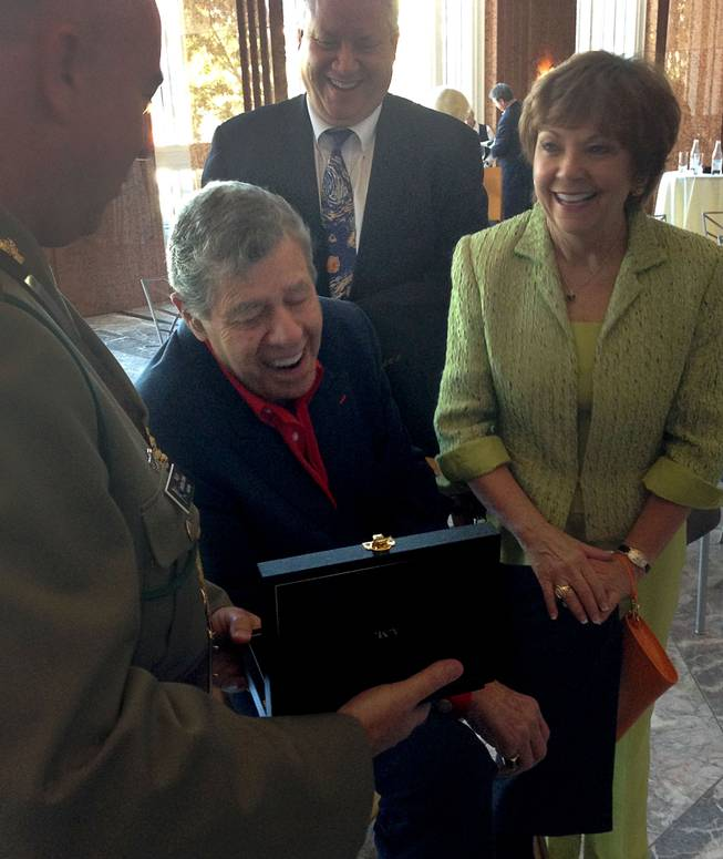 Jerry Lewis is shown with his wife, Sam, and son Chris at the Smith Center for the Performing Arts on Friday, Aug. 29, 2014, as he is shown his Member of the Order of Australia medal, which is the highest civilian honor awarded by that country. Lewis was recognized for his work with the Muscular Dystrophy Foundation of Australia.