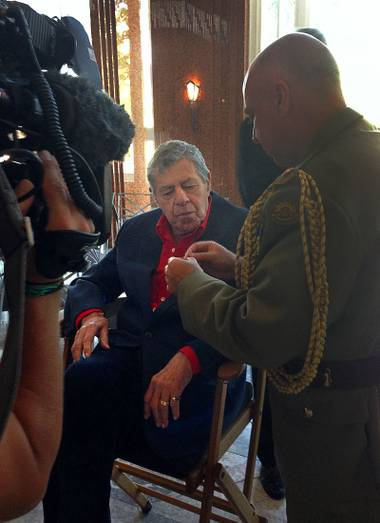 Jerry Lewis is shown his Member of the Order of Australia medal, the highest civilian honor awarded by that country,  at the Smith Center for the Performing Arts on Friday, Aug. 29, 2014. Lewis was recognized for his work with the Muscular Dystrophy Foundation of Australia.