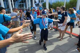 Members of the Mountain Ridge Little League team head to a bus during a ceremony at Las Vegas City Hall Saturday, Aug. 30, 2014. After the ceremony, the team boarded an double-decker, open-air Big Bus for a police-escorted parade down the Las Vegas Strip.
