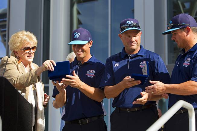 Las Vegas Mayor Carolyn Goodman hands out keys to the city during a ceremony honoring the Mountain Ridge Little League team at Las Vegas City Hall Saturday, Aug. 30, 2014. Receiving the keys from left are: manager Ashton Cave, coach Bob Kryszczuk, and coach Roland Watkins. After the ceremony, the team boarded an open-air Big Bus for a police-escorted parade down the Las Vegas Strip.