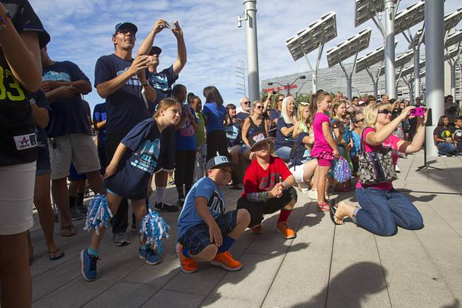 Family and friends attend a ceremony honoring the Mountain Ridge Little League team at Las Vegas City Hall Saturday, Aug. 30, 2014. After the ceremony, the team boarded an open-air Big Bus for a police-escorted parade down the Las Vegas Strip.