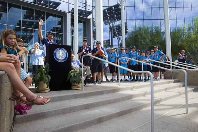 Mountain Ridge Little League manager Ashton Cave speaks during a ceremony honoring the Mountain Ridge Little League team at Las Vegas City Hall Saturday, Aug. 30, 2014. After the ceremony, the team boarded an open-air Big Bus for a police-escorted parade down the Las Vegas Strip.