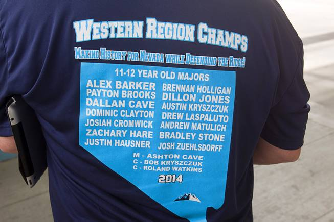 A T-shirt lists the players and coaches of the Mountain Ridge Little League team at Las Vegas City Hall Saturday, Aug. 30, 2014. After the ceremony honoring the team, the players boarded an open-air Big Bus for a police-escorted parade down the Las Vegas Strip.