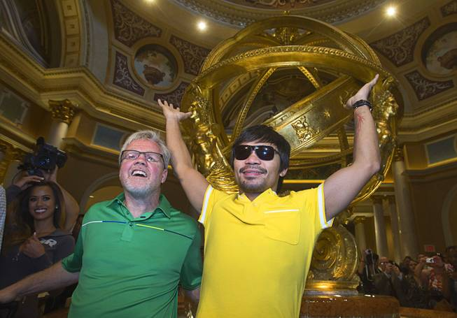 Trainer Freddie Roach, left, and boxer Manny Pacquiao of the Philippines pose in the lobby of the Venetian Saturday, Aug. 30, 2014. Pacquiao and his opponent Chris Algieri of Huntington, N.Y. are on day six of an international tour promoting their WBO welterweight title fight in Macau, China on November 22, 2014.