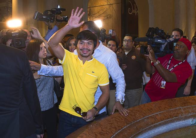 Boxer Manny Pacquiao of the Philippines waves to fans as he arrives at the Venetian Saturday, Aug. 30, 2014. Pacquiao and his opponent and Chris Algieri of Huntington, N.Y. are on day six of an international tour promoting their WBO welterweight title fight in Macau, China on November 22, 2014.