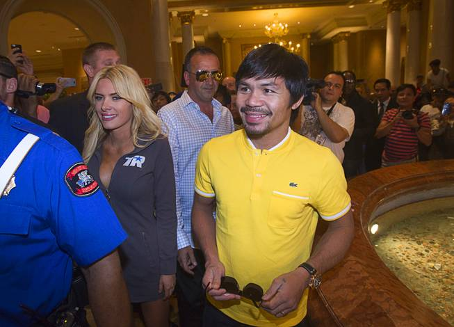 Boxer Manny Pacquiao of the Philippines arrives at the Venetian Saturday, Aug. 30, 2014. Pacquiao and his opponent and Chris Algieri of Huntington, N.Y. are on day six of an international tour promoting their WBO welterweight title fight in Macau, China on November 22, 2014.