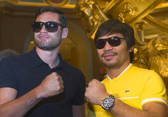 Boxers Chris Algieri, left, of Huntington, N.Y. and Manny Pacquiao of the Philippines pose in the lobby of the Venetian Saturday, Aug. 30, 2014. The boxers are on day six of an international tour promoting their WBO welterweight title fight in Macau, China on November 22, 2014.