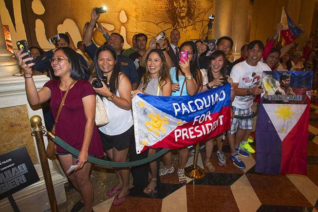 Manny Pacquiao fans wait for Pacquiao to pass by at the Venetian Saturday, Aug. 30, 2014. Pacquiao and his opponent Chris Algieri of Huntington, N.Y. are on day six of an international tour promoting their WBO welterweight title fight in Macau, China on November 22, 2014.