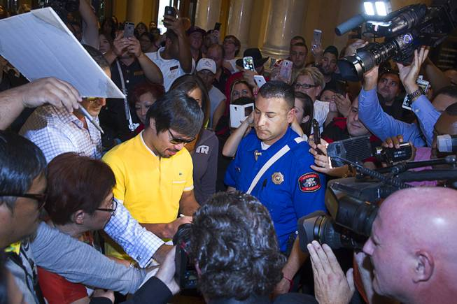 Boxer Manny Pacquiao is surrounded by media and fans as he arrives at the Venetian Saturday, Aug. 30, 2014. Pacquiao and his opponent Chris Algieri of Huntington, N.Y. are on day six of an international tour promoting their WBO welterweight title fight in Macau, China on November 22, 2014.