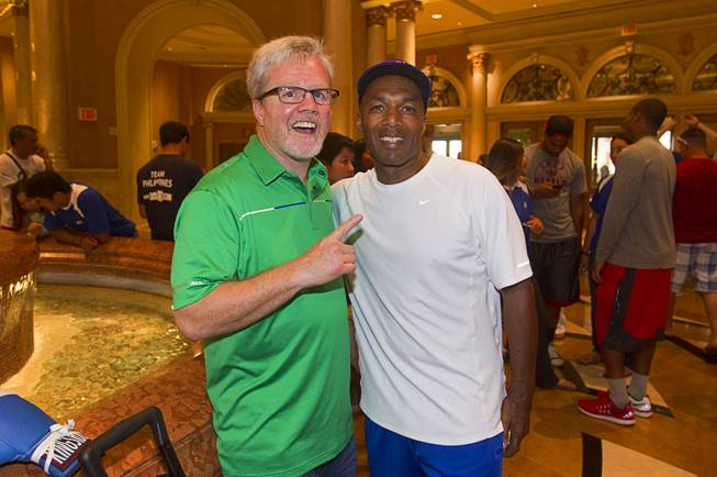 Boxing trainer Freddie Roach and former UNLV assistant boxing coach Frank Slaughter poses at the Venetian Las Vegas Resort in Las Vegas Nevada Aug. 30, 2014. Boxers Manny Pacquiao of the Philippines and Chris Algieri of Huntington, N.Y. are on day six of an international tour promoting their WBO welterweight title fight in Macau, China on November 22, 2014.