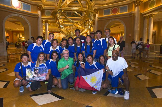 Boxing trainer Freddie Roach, center, poses with the Philippine Women's Softball team at the Venetian Las Vegas Resort in Las Vegas Nevada Aug. 30, 2014. The team is in Las Vegas training for the upcoming 17th Asian Games in Inchon, Korea. Boxers Manny Pacquiao of the Philippines and Chris Algieri of Huntington, N.Y. are on day six of an international tour promoting their WBO welterweight title fight in Macau, China on November 22, 2014.