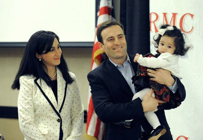 This Jan. 14, 2013, photo shows attorney Adam Laxalt introducing his wife, Jaime, and their daughter, Sophia, at the Republican Men's Club luncheon at the Atlantis Resort-Reno.