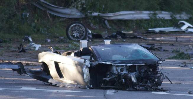 This still image taken from video shows the scene of an early morning crash in Mount Sinai, N.Y., Friday, Aug. 29, 2014. Police say 18-year-old Samuel Shepard was taking the car for a spin on a county road in Mount Sinai on Long Island early Friday when he lost control.