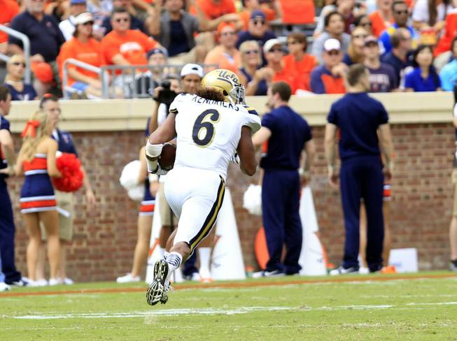 UCLA linebacker Eric Kendricks returns an interception for a touchdown during the first half of an NCAA college football game against Virginia at Scott Stadium, Saturday, Aug. 30, 2014, in Charlottesville, Va.
