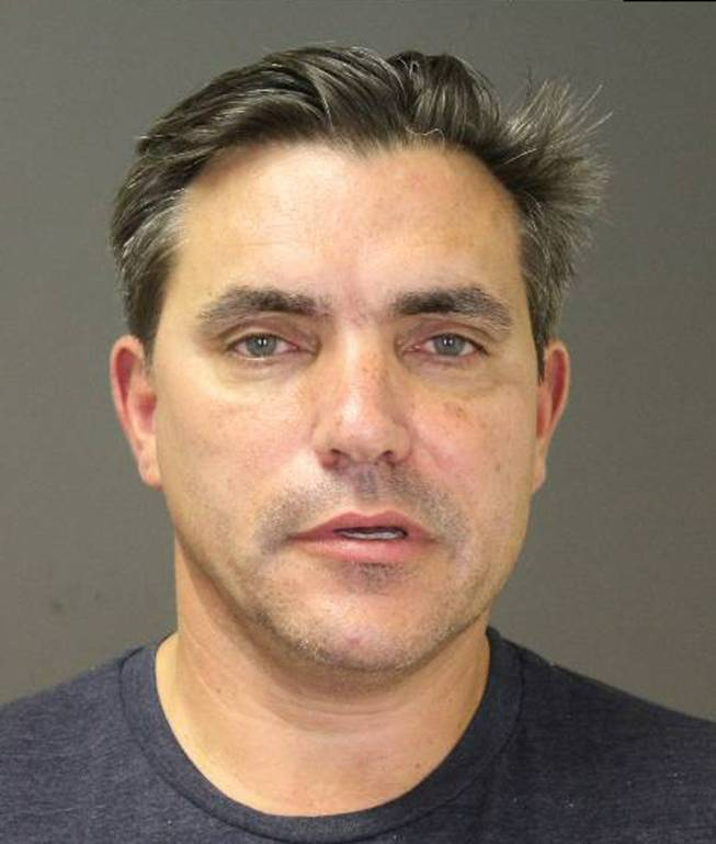 This photo provided by the Southampton Town Police Department on Long Island shows celebrity chef Todd English, 54, after his arrest early Sunday morning, Aug 31, 2014, in Southampton, N.Y., where he was charged with driving while intoxicated. Authorities say he posted $1,500 bail at Southampton Town Justice Court.