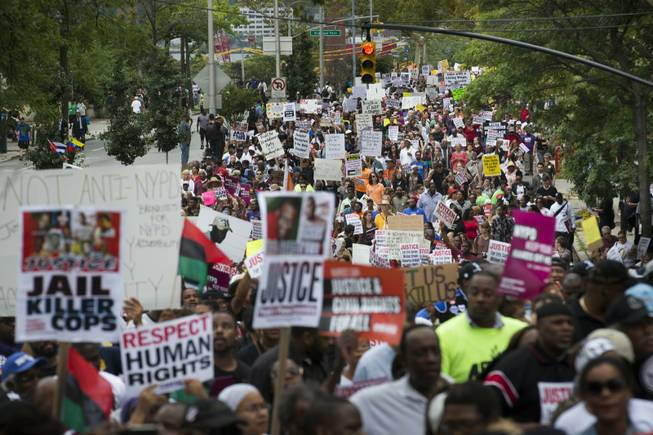 Demonstrators march to protest the death of Eric Garner in the Staten Island borough of New York. The city medical examiner ruled that Garner, 43, died as a result of a police chokehold during an attempted arrest.