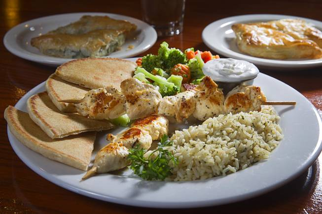 A Souvlaki Plate, foreground, Spanakopita, back left, and Tiropita are displayed at the E&N Family Table Restaurant,4460 S. Durango Dr., Sunday, Aug. 31, 2014.