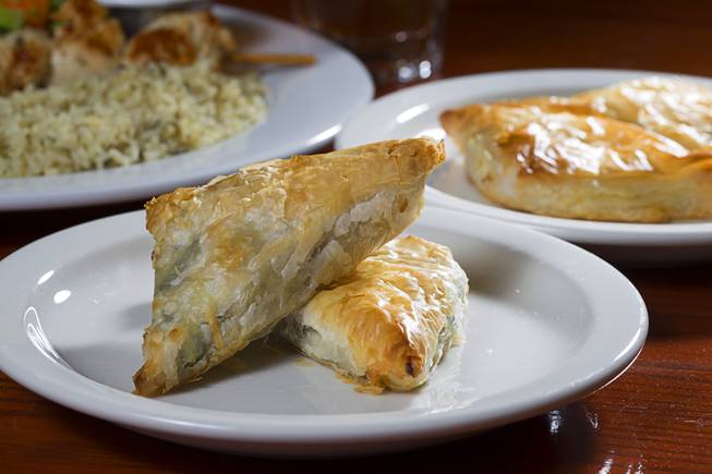 Spanakopita, left, and Tiropita are displayed at the E&N Family Table Restaurant, 4460 S. Durango Dr., Sunday, Aug. 31, 2014. Spanakopita is Greek savory pastry with spinach and feta cheese. Tiropita is the same but without the spinach.