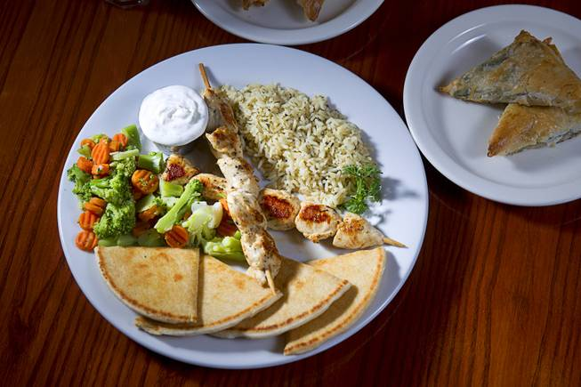 A Souvlaki Plate and Spanakopita are displayed at the E&N Family Table Restaurant, 4460 S. Durango Dr., Sunday, Aug. 31, 2014.