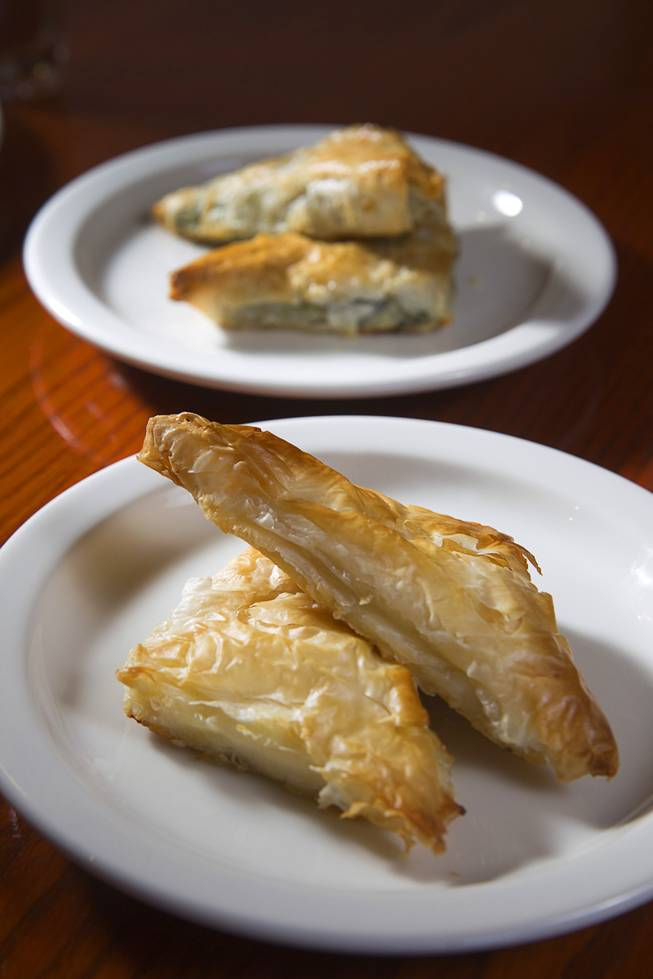 Tiropita, bottom, and Spanakopita are displayed at the E&N Family Table Restaurant, 4460 S. Durango Dr., Sunday, Aug. 31, 2014. Tiropita is Greek savory pastry with feta cheese. Spanakopita is the same but with feta cheese and spinach.
