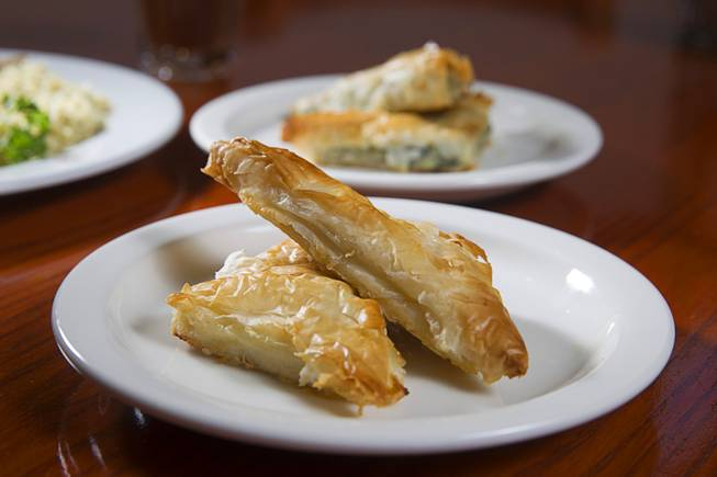 Tiropita, left, and Spanakopita are displayed at the E&N Family Table Restaurant, 4460 S. Durango Dr., Sunday, Aug. 31, 2014. Tiropita is Greek savory pastry with feta cheese. Spanakopita is the same but with feta cheese and spinach.