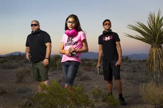 Jeff (last name withheld) poses with his daughter McKenna, 9, and his son Tyler, 13, in the desert near Summerlin Sunday, Aug. 31, 2014.
