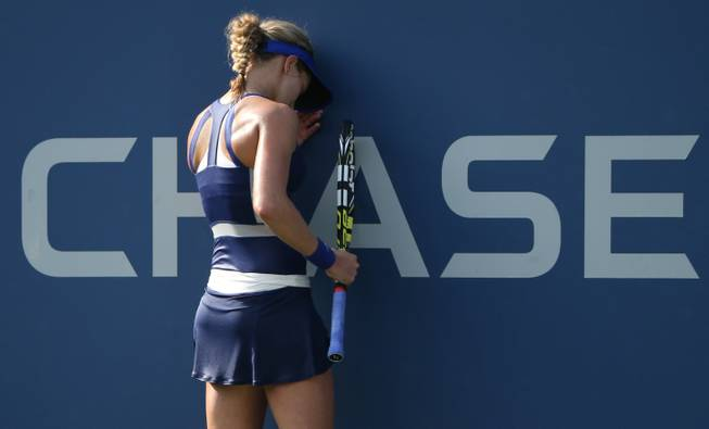 Eugenie Bouchard, of Canada, reacts after a shot against Ekaterina Makarova, of Russia, during the fourth round of the 2014 U.S. Open tennis tournament, Monday, Sept. 1, 2014, in New York.