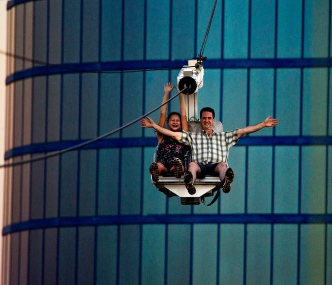 Riders gather some speed while taking on the Voodoo Zipline atop The Rio Hotel and Casino on Thursday, August 28, 2014.