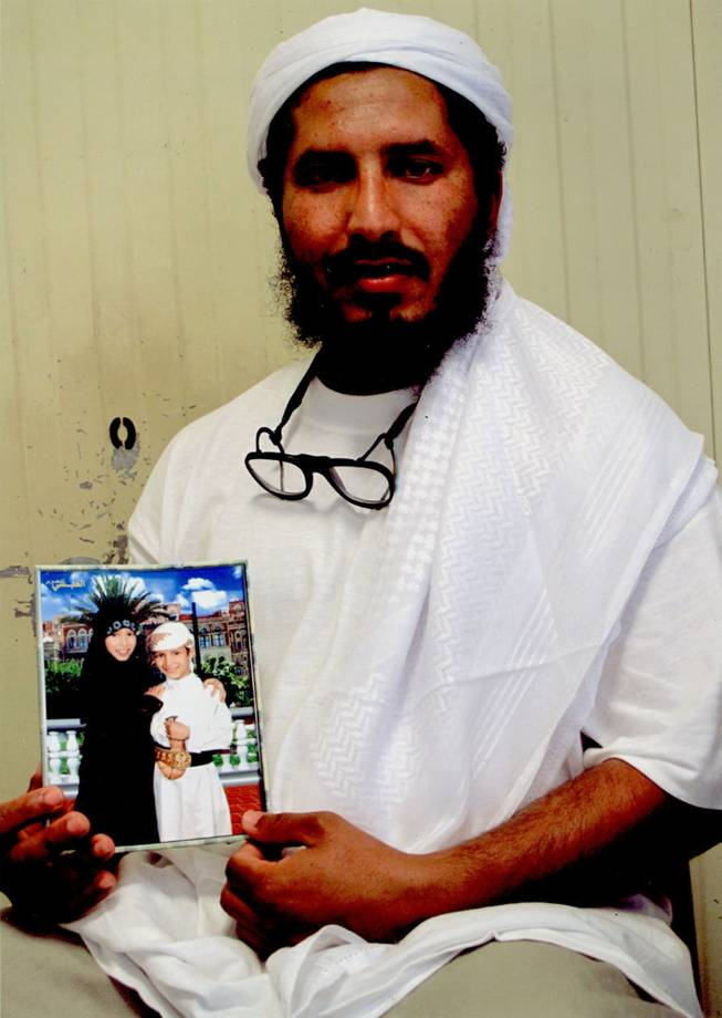 In this undated photo released by the family of Ahmed al-Darbi on Friday, Aug. 7, 2009, which was provided to them by the International Committee of the Red Cross, Guantanamo detainee Ahmed al-Darbi is seen at Camp 4 of the detention center on Guantanamo Bay Naval Base in Cuba. A Guantanamo Bay prisoner pleaded guilty Thursday to war crimes charges for helping plan the suicide bombing of an oil tanker off Yemen in 2002 that killed a crewman and wounded a dozen others. At an arraignment before a U.S. military judge, Ahmed al-Darbi of Saudi Arabia pleaded guilty to the five charges against him including terrorism, attacking civilians and hazarding a vessel for complicity in the al-Qaida attack on the French-flagged MV Limburg.