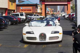 WBC/WBA welterweight champion Floyd Mayweather Jr. arrives in a Bugatti Veyron Grand Sport Vitesse during a media day at the Mayweather Boxing Club Tuesday, Sept. 2, 2014. Mayweather will face Marcos Maidana of Argentina in a rematch at the MGM Grand Garden Arena on Saturday, Sept. 13.