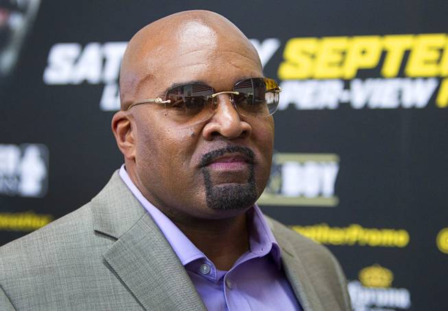 Leonard Ellerbe, CEO of Mayweather Promotions, watches as WBC/WBA welterweight champion Floyd Mayweather Jr. speaks with reporters during a media day at the Mayweather Boxing Club Tuesday, Sept. 2, 2014. Mayweather will face Marcos Maidana of Argentina in a rematch at the MGM Grand Garden Arena on Saturday, Sept. 13.