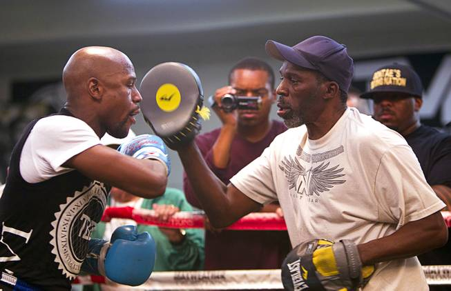 WBC/WBA welterweight champion Floyd Mayweather Jr., left, works on his timing with uncle and trainer Roger May weather during a media day at the Mayweather Boxing Club Tuesday, Sept. 2, 2014. Mayweather will face Marcos Maidana of Argentina in a rematch at the MGM Grand Garden Arena on Saturday, Sept. 13.