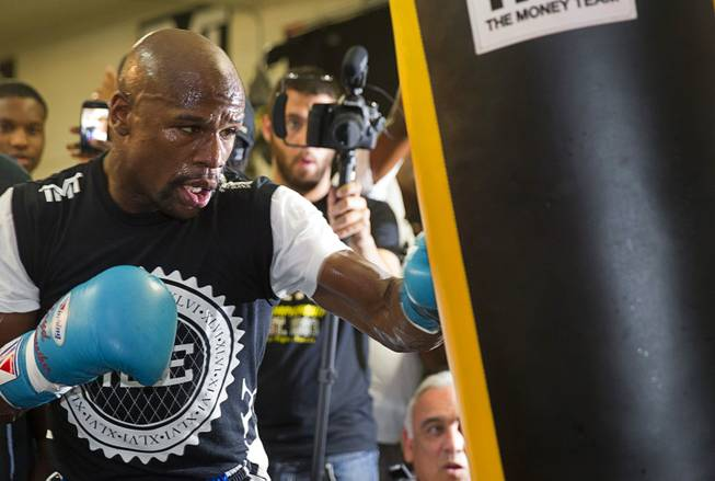 WBC/WBA welterweight champion Floyd Mayweather Jr. hits a heavy bag during a media day at the Mayweather Boxing Club Tuesday, Sept. 2, 2014. Mayweather will face Marcos Maidana of Argentina in a rematch at the MGM Grand Garden Arena on Saturday, Sept. 13.