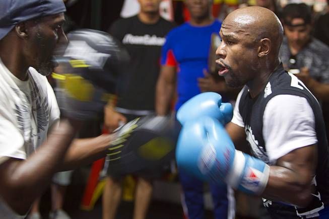 WBC/WBA welterweight champion Floyd Mayweather Jr., right, works on his timing with uncle and trainer Roger May weather during a media day at the Mayweather Boxing Club Tuesday, Sept. 2, 2014. Mayweather will face Marcos Maidana of Argentina in a rematch at the MGM Grand Garden Arena on Saturday, Sept. 13.
