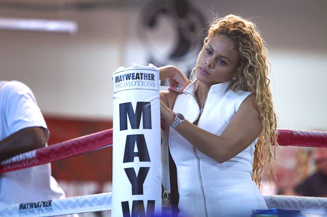 Liza Hernandez, Floyd Mayweather Jr.'s girlfriend, watches Mayweather work out during a media day at the Mayweather Boxing Club Tuesday, Sept. 2, 2014. Mayweather will face Marcos Maidana of Argentina in a rematch at the MGM Grand Garden Arena on Saturday, Sept. 13.