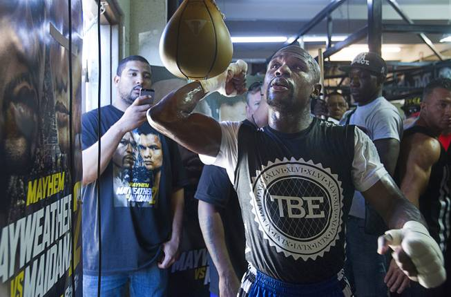WBC/WBA welterweight champion Floyd Mayweather Jr. hits a speedbag during a media day at the Mayweather Boxing Club Tuesday, Sept. 2, 2014. Mayweather will face Marcos Maidana of Argentina in a rematch at the MGM Grand Garden Arena on Saturday, Sept. 13.