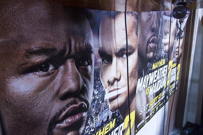 "Images of WBC/WBA welterweight champion Floyd Mayweather Jr. and Marcos Maidana are seen on a poster at the Mayweather Boxing Club Tuesday, Sept. 2, 2014. Tape covers Maidana;s mouth because, ""he talks too much,"" said cutman Rafael Garcia. Mayweather will face Marcos Maidana of Argentina in a rematch at the MGM Grand Garden Arena on Saturday, Sept. 13."