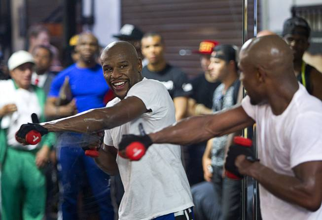 WBC/WBA welterweight champion Floyd Mayweather Jr. works out in front of a mirror during a media day at the Mayweather Boxing Club Tuesday, Sept. 2, 2014. Mayweather will face Marcos Maidana of Argentina in a rematch at the MGM Grand Garden Arena on Saturday, Sept. 13.