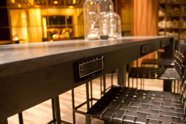 A/C power plug and USB power outlets are embedded along tabletops at 3940 Coffee + Tea at the new Delano Las Vegas on Tuesday, Sept. 2, 2014.
