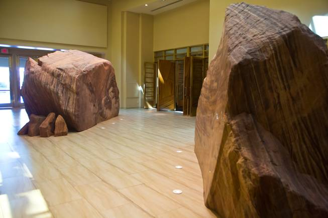 A 700 million-year-old metaquartzite and brass boulder is on display at the valet entrance at the new Delano Las Vegas on Tuesday, Sept. 2, 2014.
